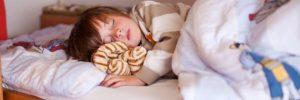 Boy Sleeping On Bunk Bed