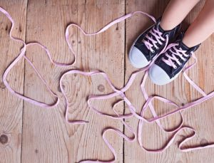 The problem - childs feet and long twisted shoelaces