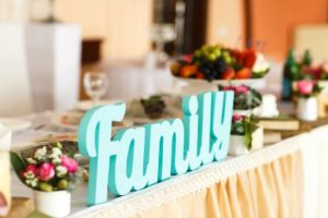 blue color word family at the wedding table near flowers